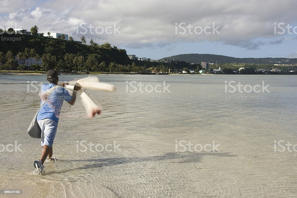 Throwing Cast Net 1 royalty-free stock photo
