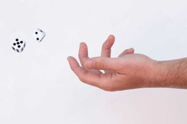 throwing dice A man throwing dice jude beck stock pictures, royalty-free photos & images