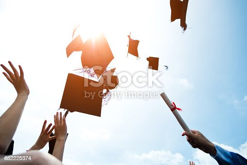 959532468 istock photo throwing graduation hats 652225374