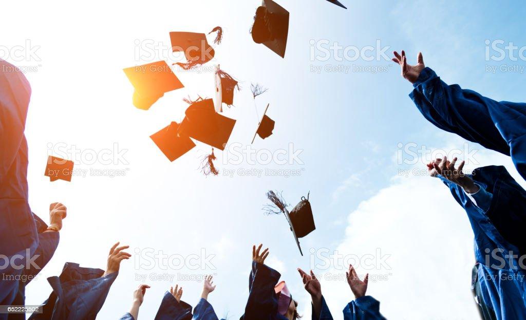 throwing graduation hats stock photo