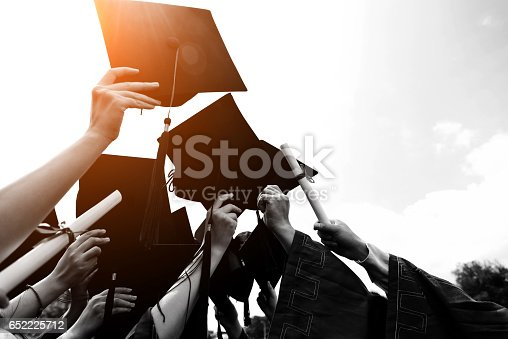 1009462356 istock photo throwing graduation hats 652225712
