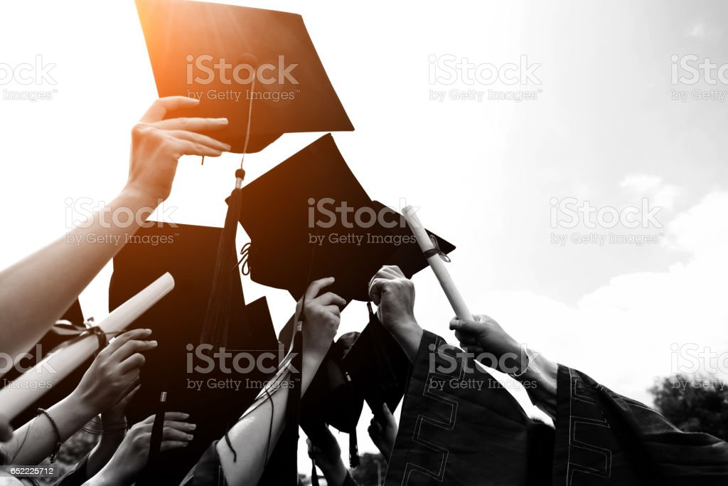 throwing graduation hats stock photo