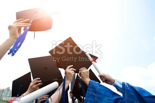 959532468 istock photo throwing graduation hats 652225780