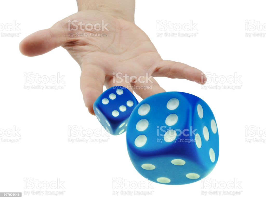 Throwing or rolling dice closeup isolated stock photo