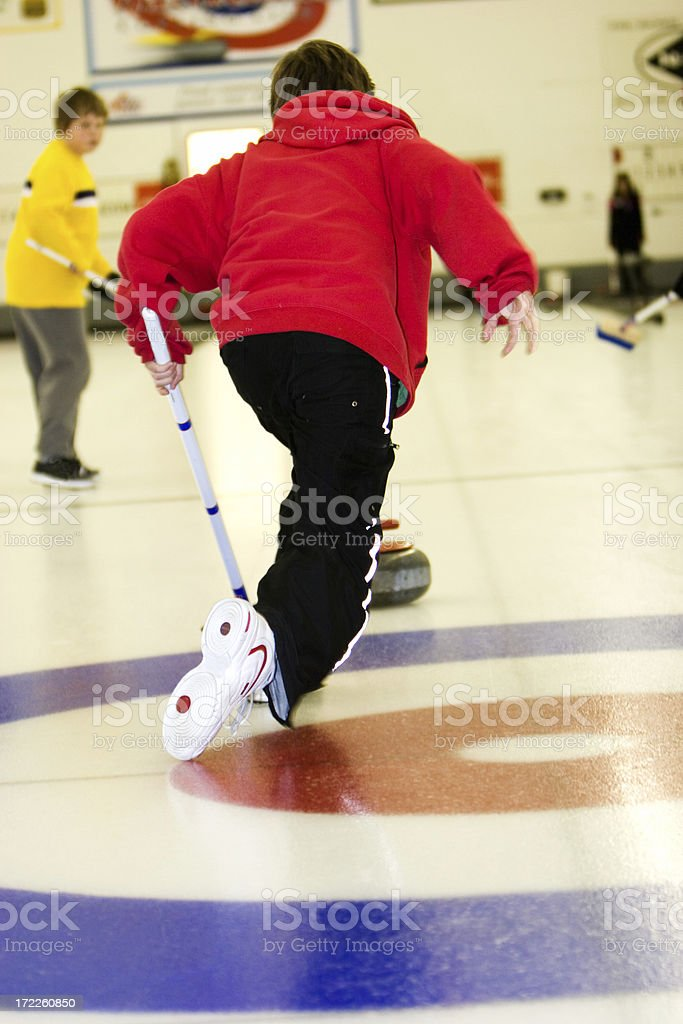 Throwing the curling rock royalty-free stock photo