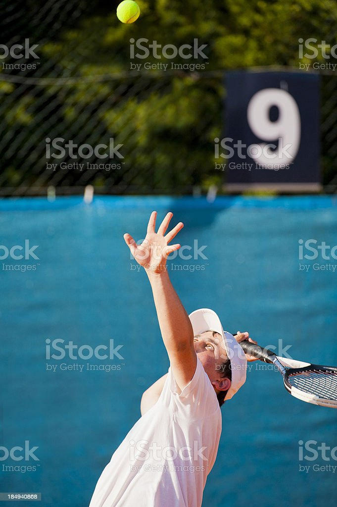 Throwing the tennis ball for serving stock photo