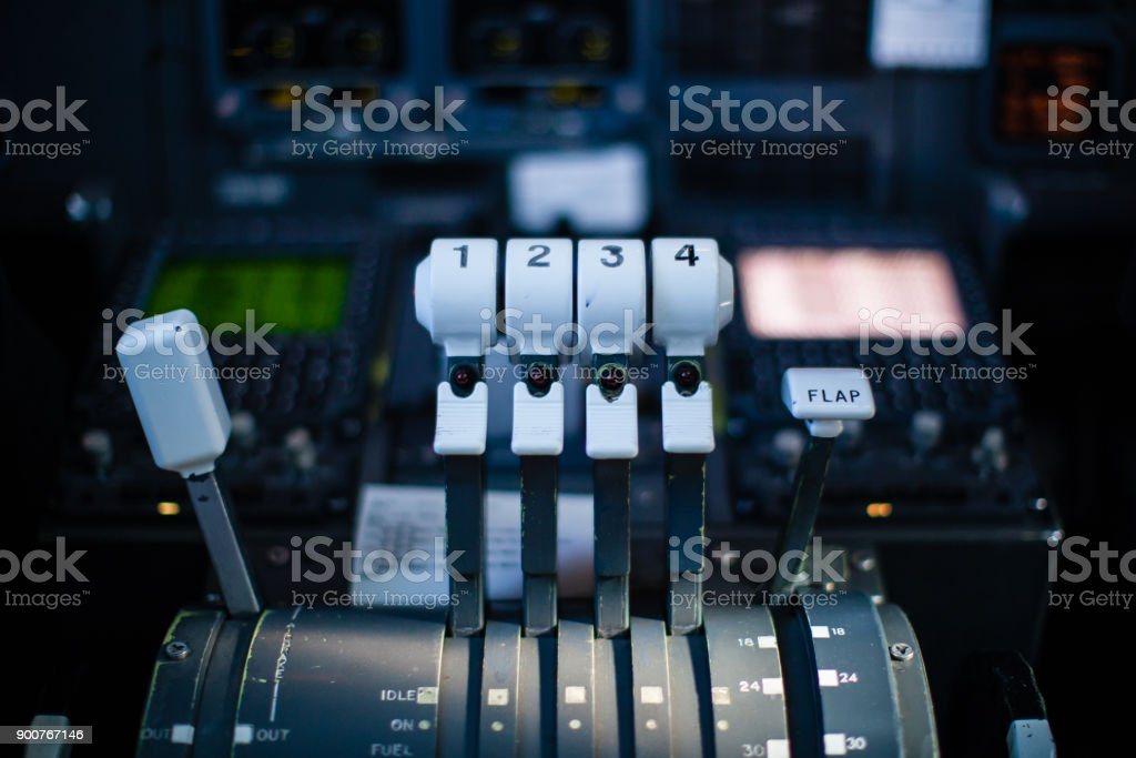Thrust levers in the cockpit and control panel stock photo