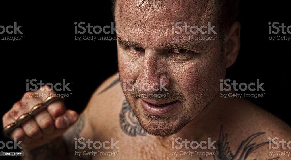 Thug with Brass stock photo