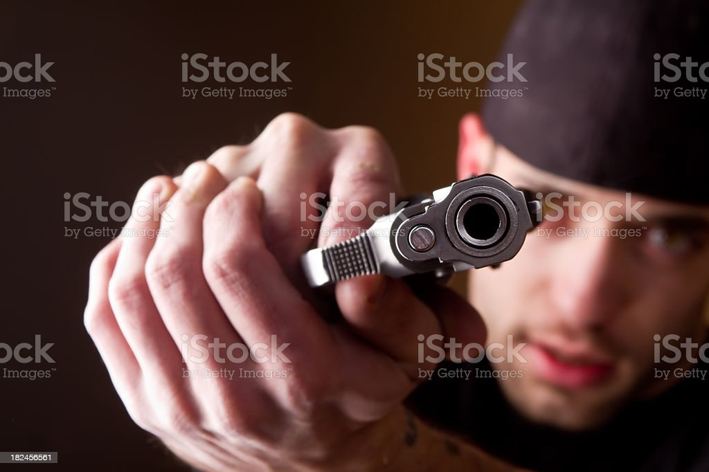 Thug with Handgun stock photo