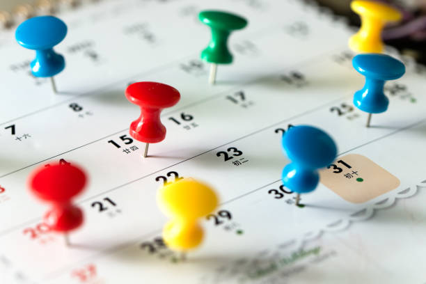 Thumb tack pins on calendar as reminder Various color thumb tack pins on calendar as reminder full stock pictures, royalty-free photos & images