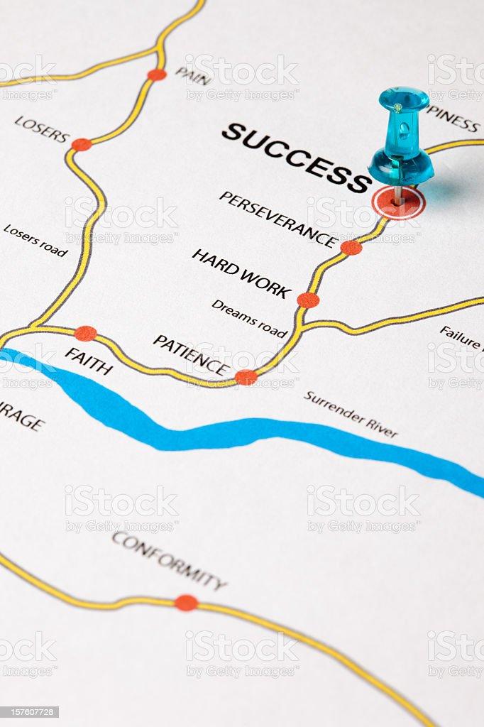 Thumb tack targeting success on a map royalty-free stock photo