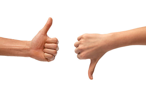 thumb up and down hand signs - thumbs down stock photos and pictures