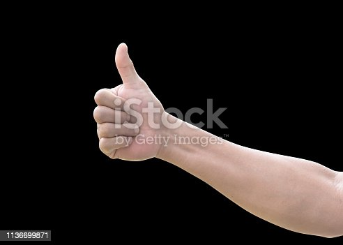 693589426istockphoto Thumb up of man's  hand isolated on white background with clipping path for like, approval and agreement 1136699871
