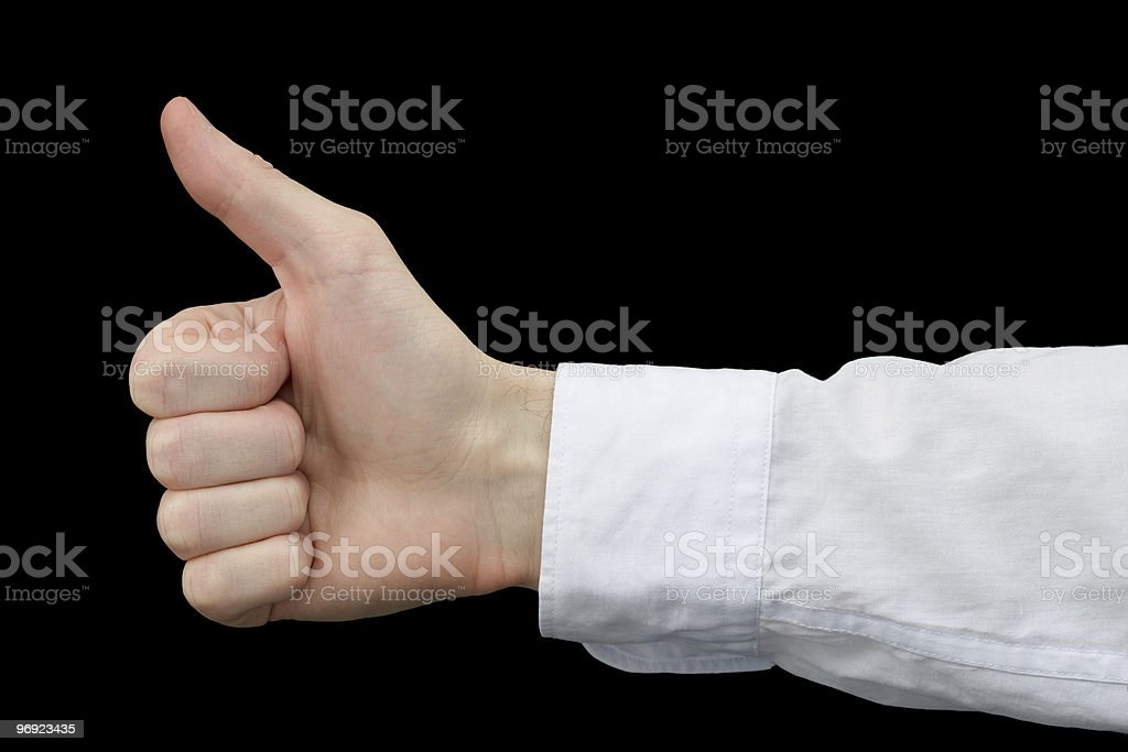 Thumb up on black background royalty-free stock photo