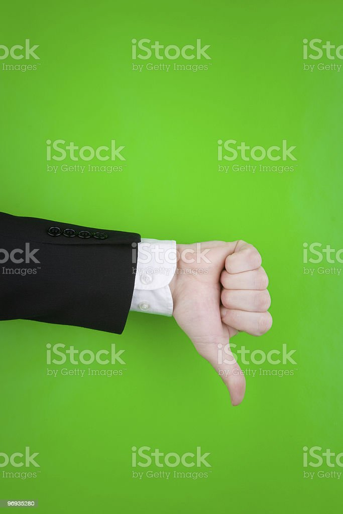 Thumbs down gesture on green royalty-free stock photo