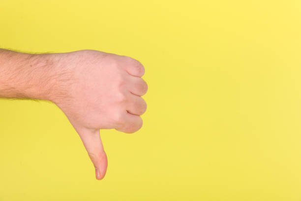 thumbs down - thumbs down stock photos and pictures