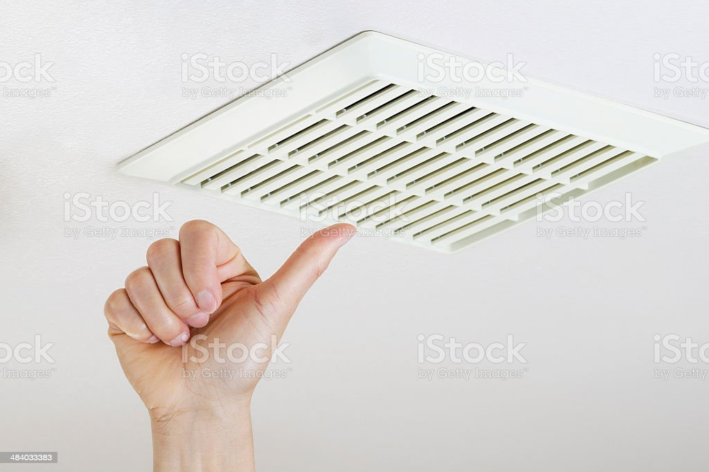 Thumbs Up after successfully cleaning and installing fan vent stock photo