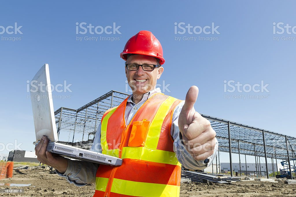 Thumbs up and a Laptop royalty-free stock photo
