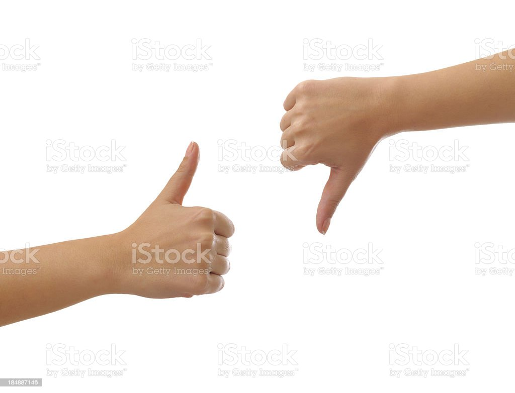 Thumbs up and  down stock photo