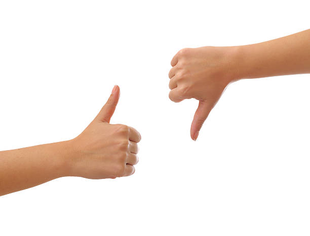 thumbs up and  down - thumbs down stock photos and pictures