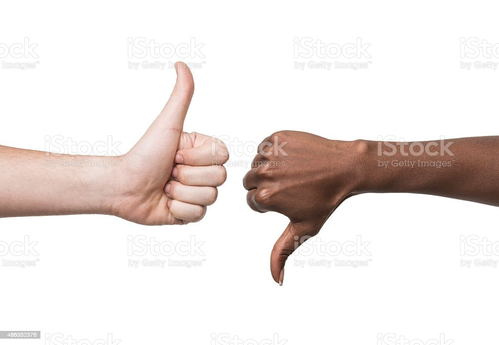 Thumbs Up and down signs with mixed race couple Thumbs up and thumbs down sign on white background 2015 Stock Photo