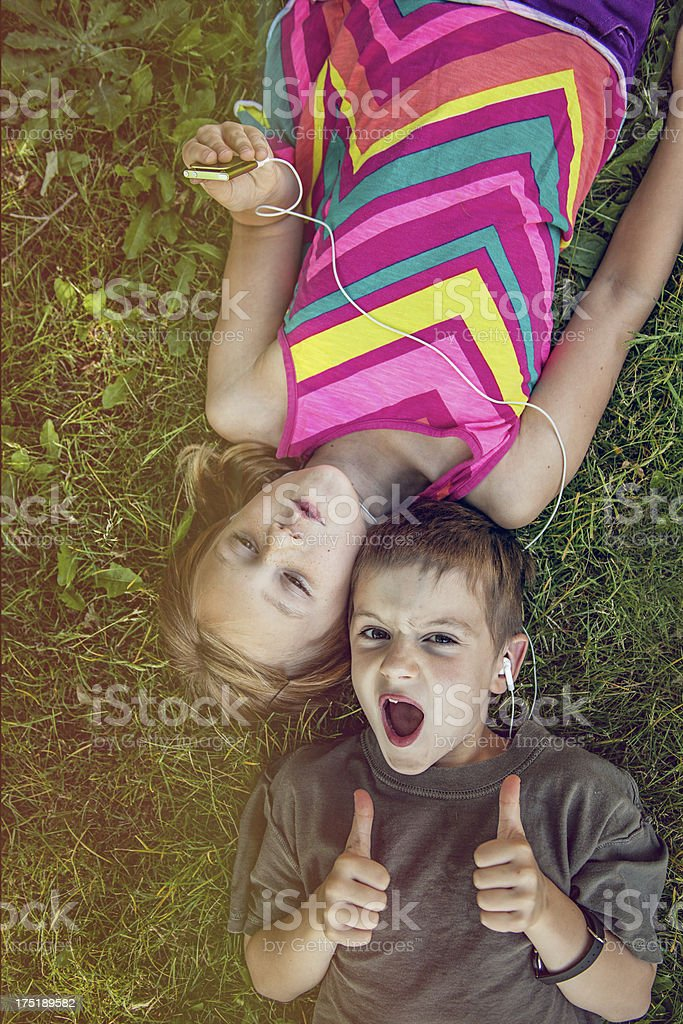 Thumbs up Boy and Girl listening to MP3 Player royalty-free stock photo