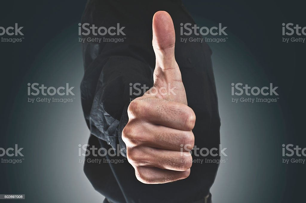 Businessman showing OK sign / Thumbs up