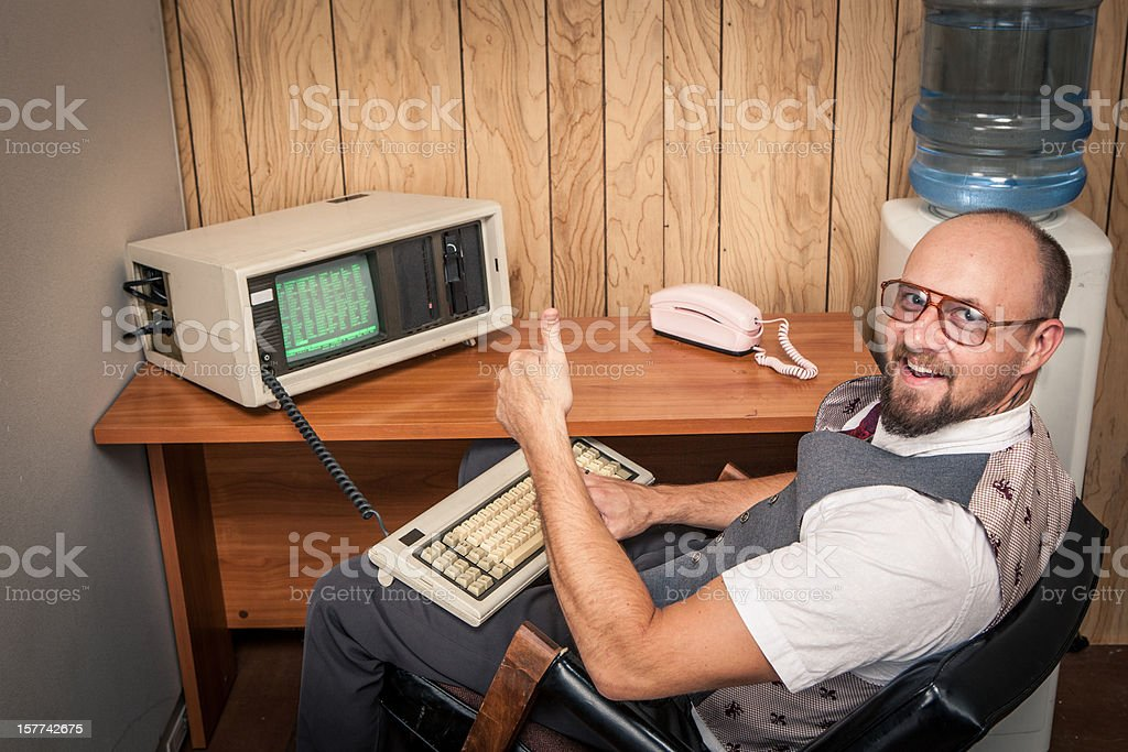 Thumbs up computer worker nerd  on phone at cubicle stock photo