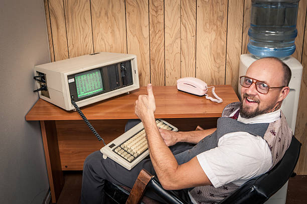 thumbs up computer worker nerd  on phone at cubicle - 1980s style stock photos and pictures