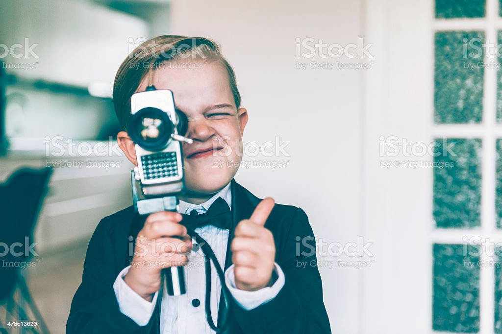 Thumbs up from boy shooting video with retro camera - Royalty-free Homevideocamera Stockfoto