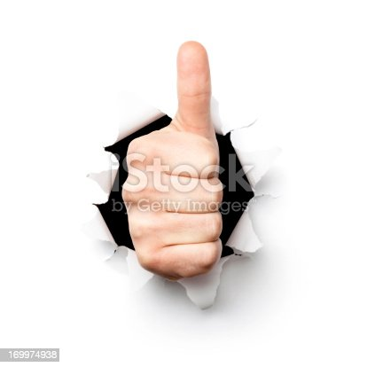 472273278 istock photo Thumbs up. Hand Tearing Hole Torn Paper Isolated Concept 169974938