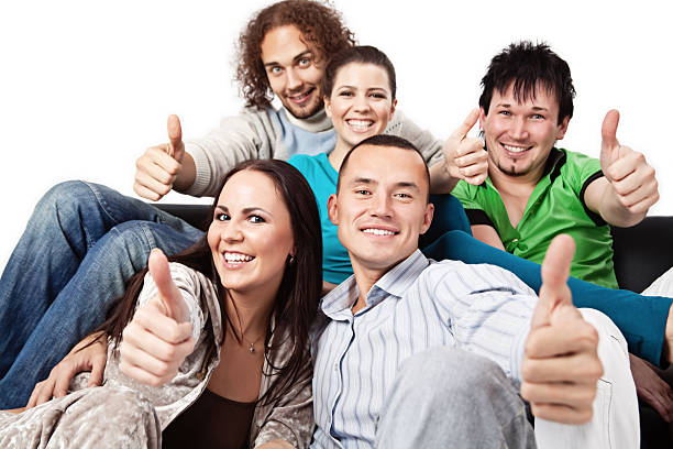 Thumbs up - happy young people stock photo