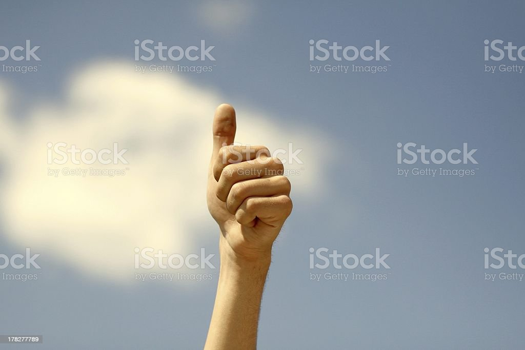 thumbs up in the sky stock photo