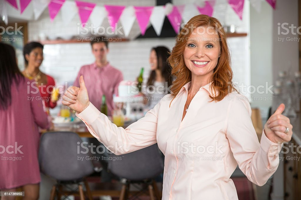 Thumbs up mature senior elder woman mother family gathering group stock photo