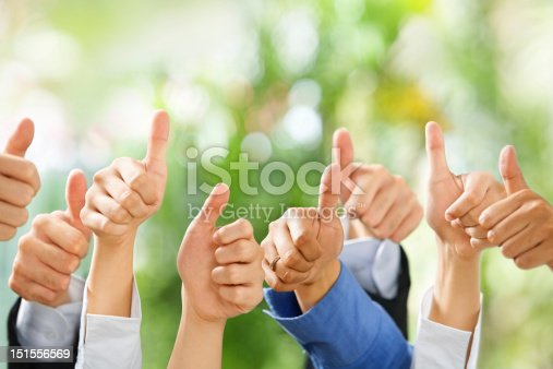istock Thumbs up on green background 151556569