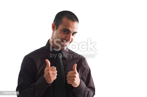 Young man of Middle Eastern ethnicity gives a happy thumbs up okay gesture.