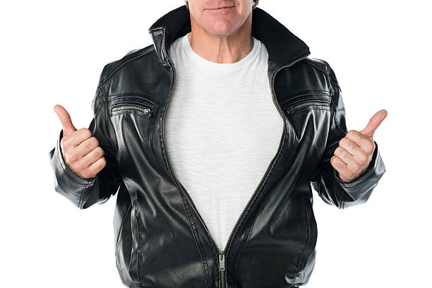 Thumbs Up Mid forties confident male in a black leather jacket, with thumbs up. T-shirt has blank copy space leather jacket stock pictures, royalty-free photos & images