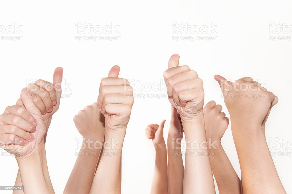 Thumbs up positive sign on white background royalty-free stock photo