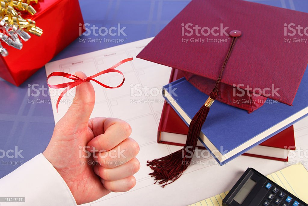 Thumbs Up Ribbon: Graduation Celebration, Cap, Books, Gift stock photo