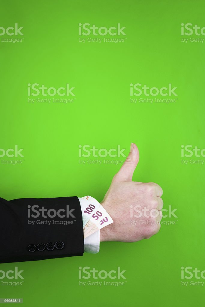 Thumbs up sign and money royalty-free stock photo