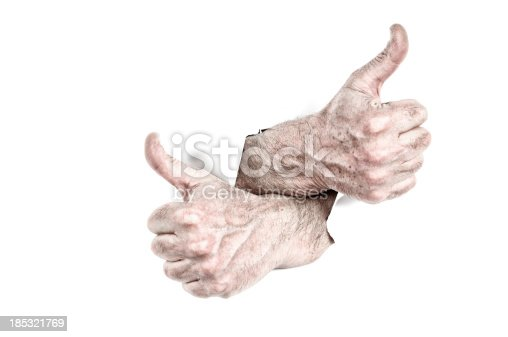170011440 istock photo Thumbs Up Tearing Hole 185321769