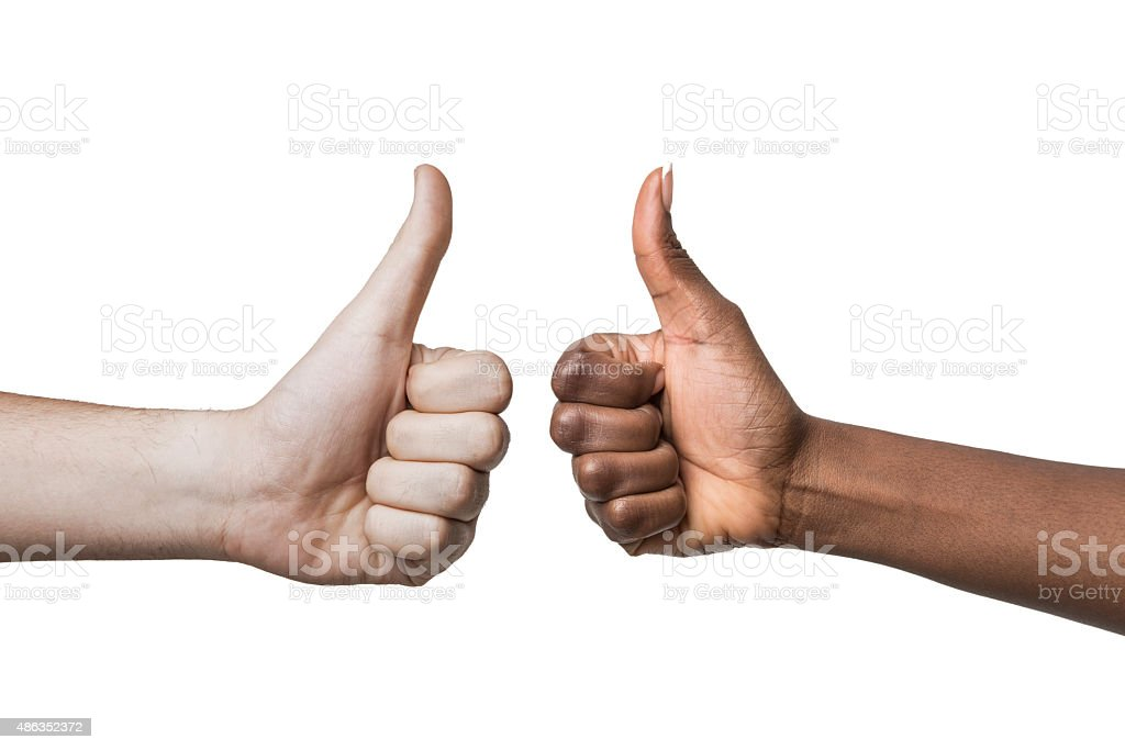 Thumbs-up signal from a pair of mixed race couple stock photo