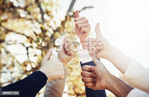 888892364istockphoto Thumbs-up to a great team 888892350