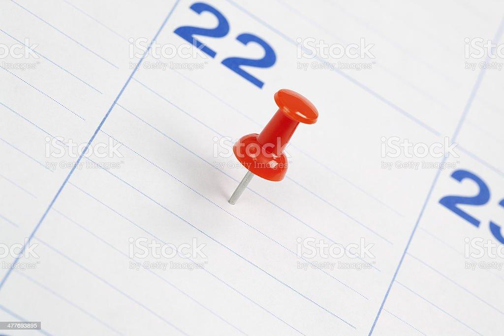 Thumbtack in a Calendar royalty-free stock photo