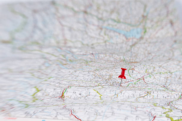 thumbtack on huge map - road map stock photos and pictures