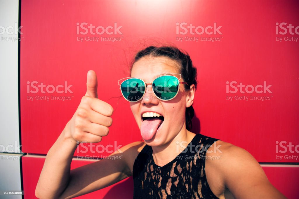 Thump up and tongue out stock photo
