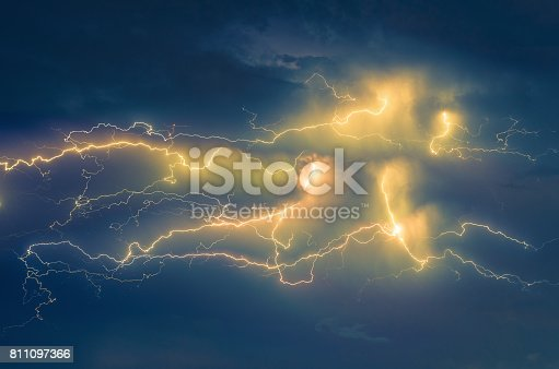 istock thunder lightnings and storm on the sky with cloud background 811097366