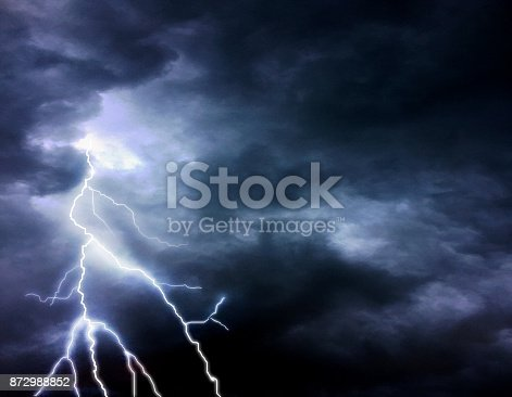 istock Thunder, lightnings and stormy sky in summer 872988852