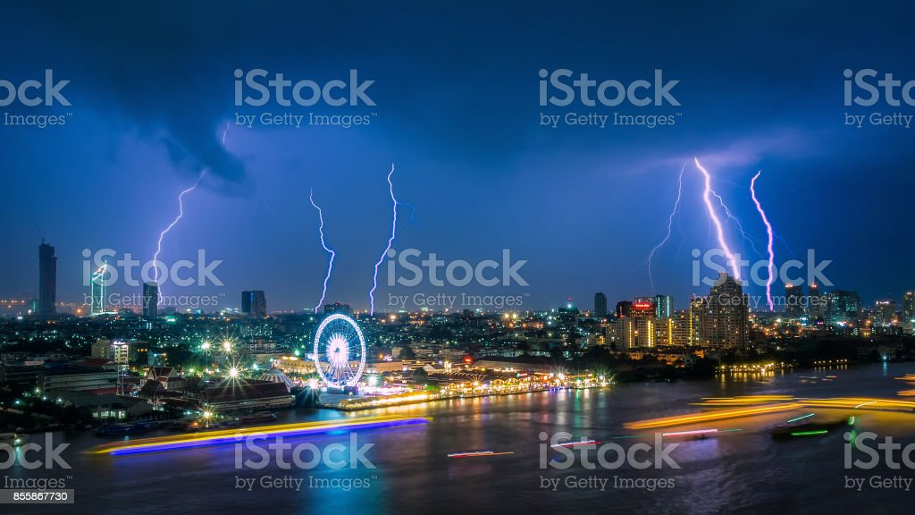 Thunder storm lightning strike on the dark cloudy sky stock photo