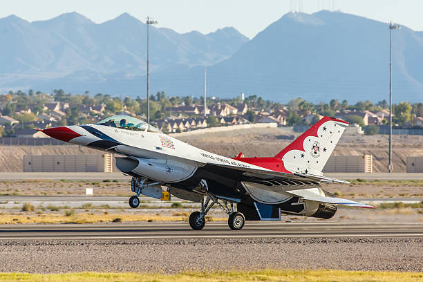 usaf thunderbirds lands on a runway at nellis afb - sonic boom stock photos and pictures